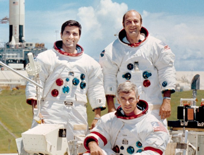 Apollo 17 lunar landing mission are: Commander, Eugene A. Cernan (seated), Command Module pilot Ronald E. Evans (standing on right), and Lunar Module pilot, Harrison H. Schmitt.