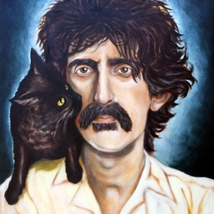 Frank Zappa poses with a black cat perched on his shoulders.