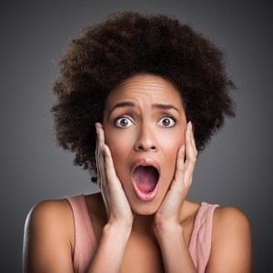 scared black woman with afro
