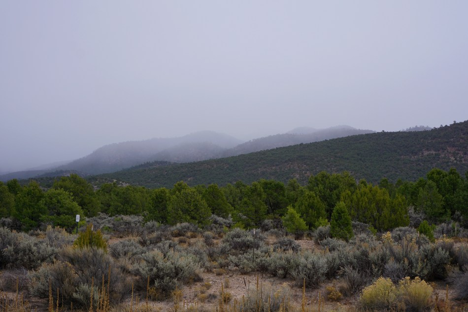 Misty rain clouds hovering over mountains, Taos, New Mexico, USA © 2018 ericarobbin.com | All rights reserved.