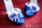 Blue wedding shoes detail with feathers