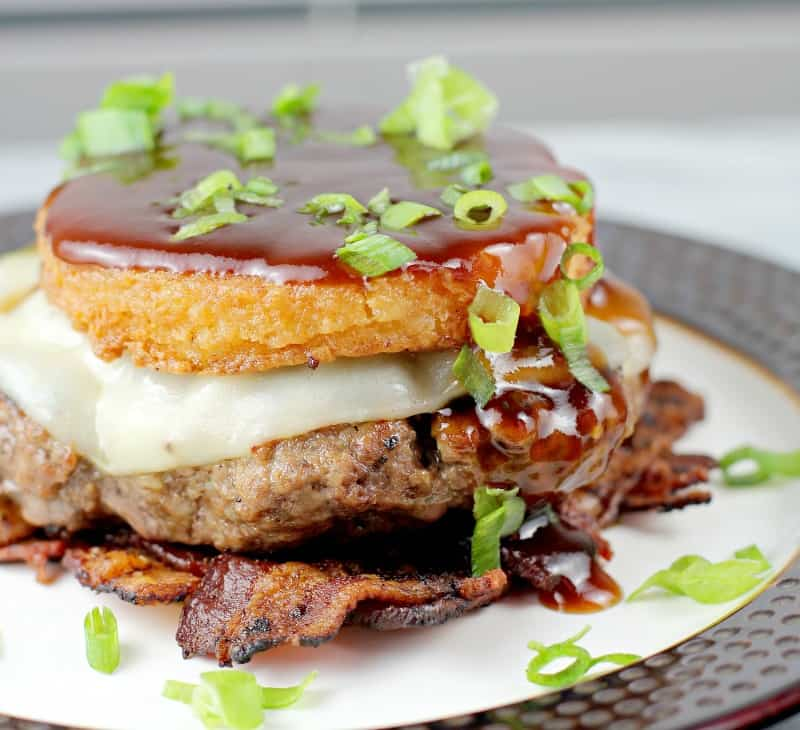 Low Country BBQ Burger with Bacon Weave and Smoked Gouda Grit Cake