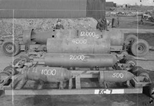 Photo showing relative size of British bombs of the Second World War. They ranging from 500 lb to 12,000 lb. As the main recipient of such bombs from Britain and America, Germany remains a graveyard for unexploded bombs. Some 2,000 tons of them are discovered annually. [Photo created by the United Kingdom Government is in the public domain; Wikimedia Commons, Raf ww2 bombs.jpg] https://upload.wikimedia.org/wikipedia/commons/3/34/Raf_ww2_bombs.jpg