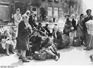 Refugees in Berlin in 1945 waiting for a train. From Bundes... (link)