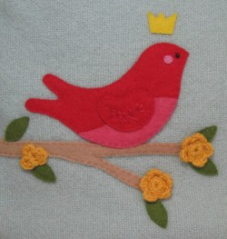 detail of red bird applique