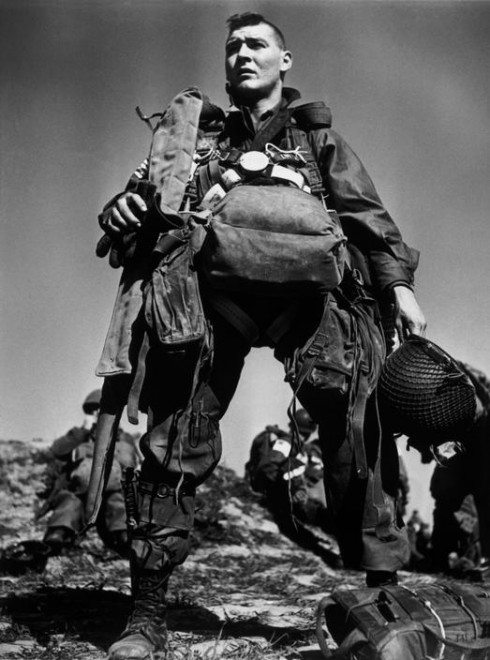 Robert Capa / Magnum Photos. FRANCE. Arras. March 23rd, 1945. An American Parachutist preparing to board the plane for the jump accross the Rhine River.