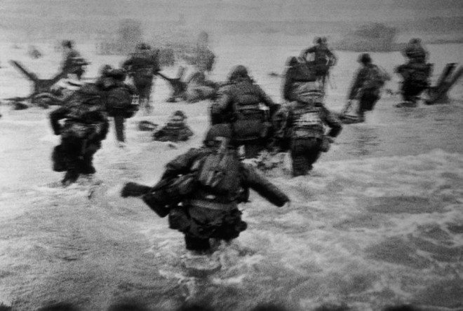 Robert Capa / Magnum Photos. FRANCE. Normandy. June 6th, 1944. Landing of the American troops on Omaha Beach.