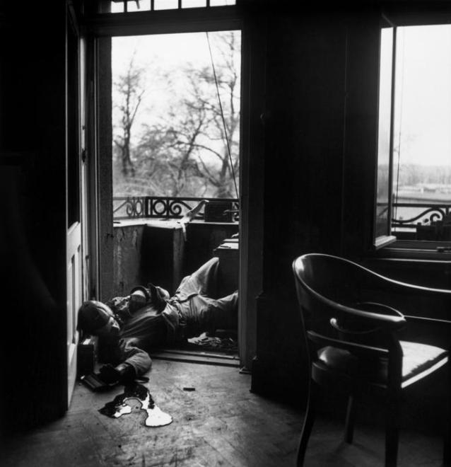Robert Capa / Magnum Photos. GERMANY. Leipzig. April 18, 1945. American soldierkilled by a German sniper.