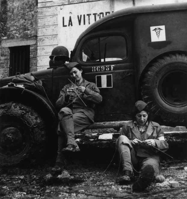 Robert Capa / Magnum Photos. ITALY. 1944. Drivers from the French ambulance corps near the front, waiting to be called.