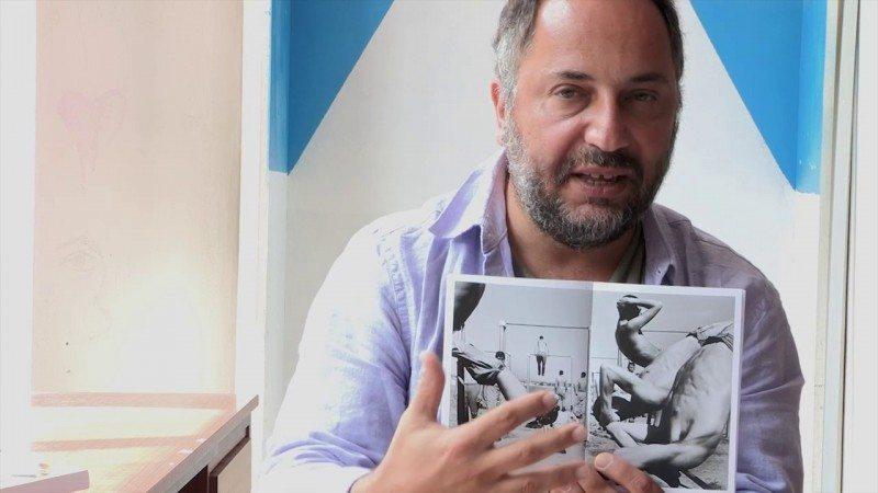 "Jason Eskenazi and a copy of ""Wonderland"""