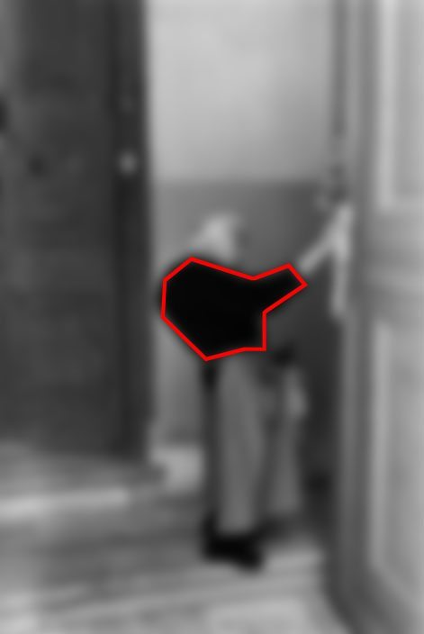 Note how the dark color of her jacket is the darkest value (brightness-wise) in the scene. The second darkest point is the door, then the wall behind the woman, then lastly the door.