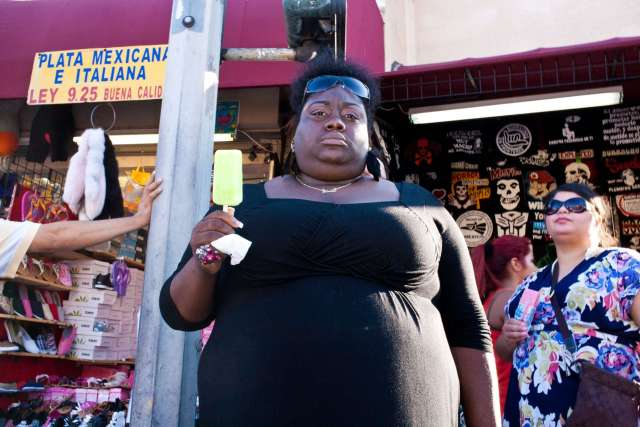 Downtown LA, 2011. Shot on a Canon 5D, 35mm f/2 lens. black woman with popsicle
