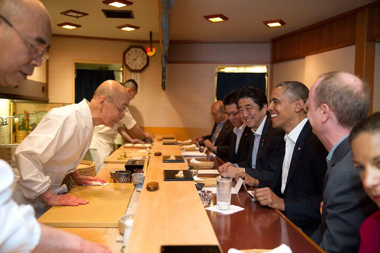 President Barack Obama and Prime Minister Shinzo Abe of Japan talk with sushi master Jiro Ono, owner of Sukiyabashi Jiro sushi restaurant, during a dinner in Tokyo, Japan, April 23, 2014. (Official White House Photo by Pete Souza) This official White House photograph is being made available only for publication by news organizations and/or for personal use printing by the subject(s) of the photograph. The photograph may not be manipulated in any way and may not be used in commercial or political materials, advertisements, emails, products, promotions that in any way suggests approval or endorsement of the President, the First Family, or the White House.