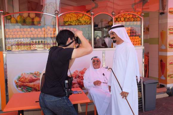 Shooting a street portrait in Dubai.