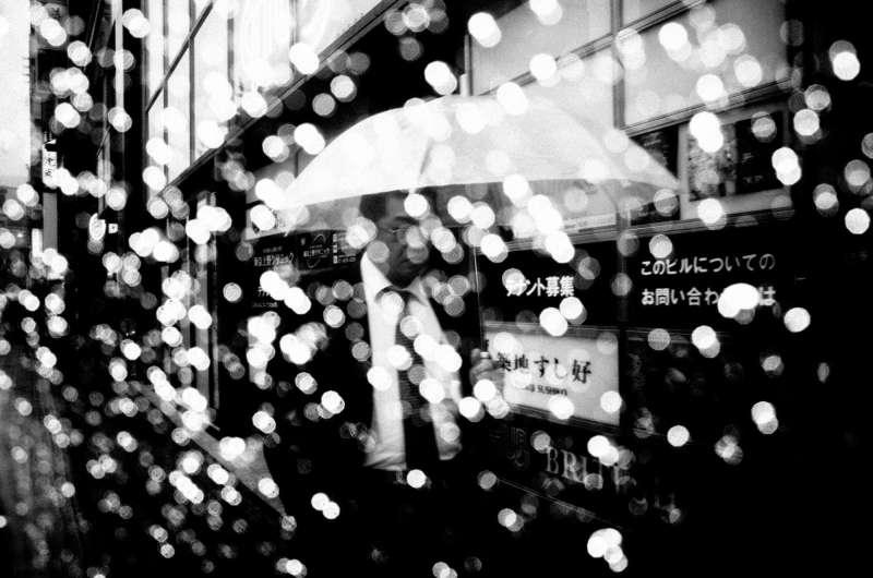 Shinjuku, Tokyo, 2016 eric kim street photography umbrella rain