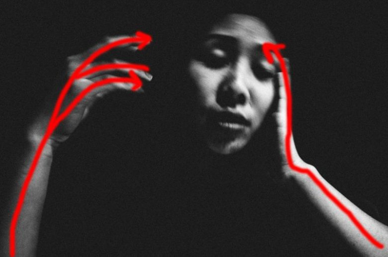 Outlined in red. Cindy's hands, curved in motion. Note her elbows coming out of the bottom left and bottom right of the frame.