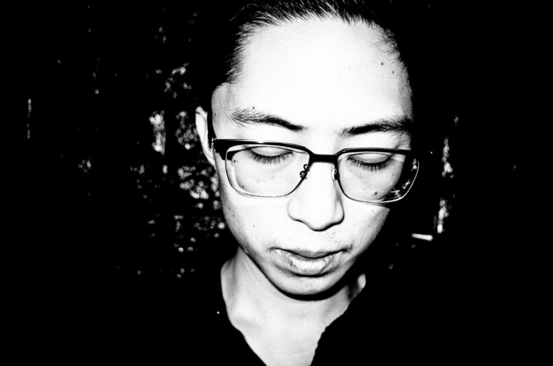eric kim photography black and white hanoi-0009770-self portrait - looking down self portrait