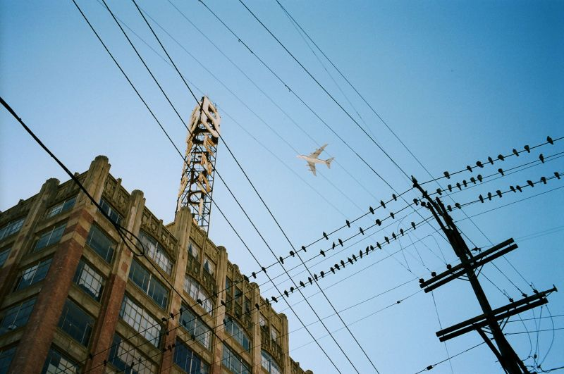 eric kim color photography airplane blue wires