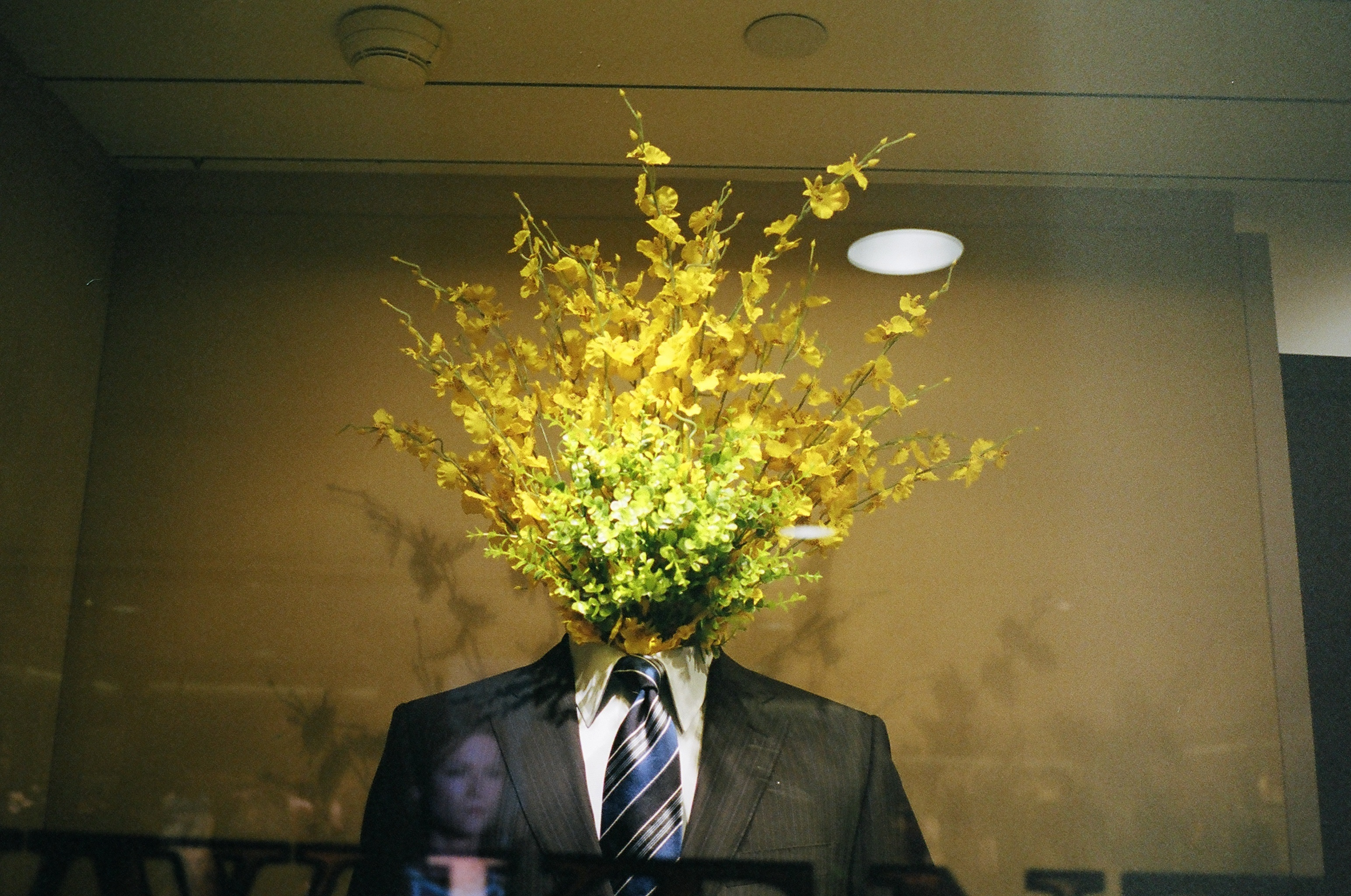 Suit head replaced with flowers