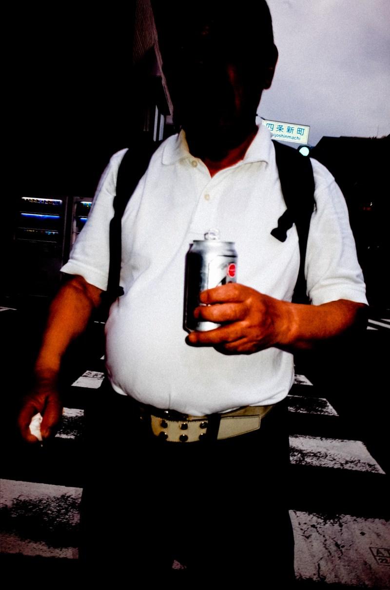 Black headless man with beer. Kyoto, 2017