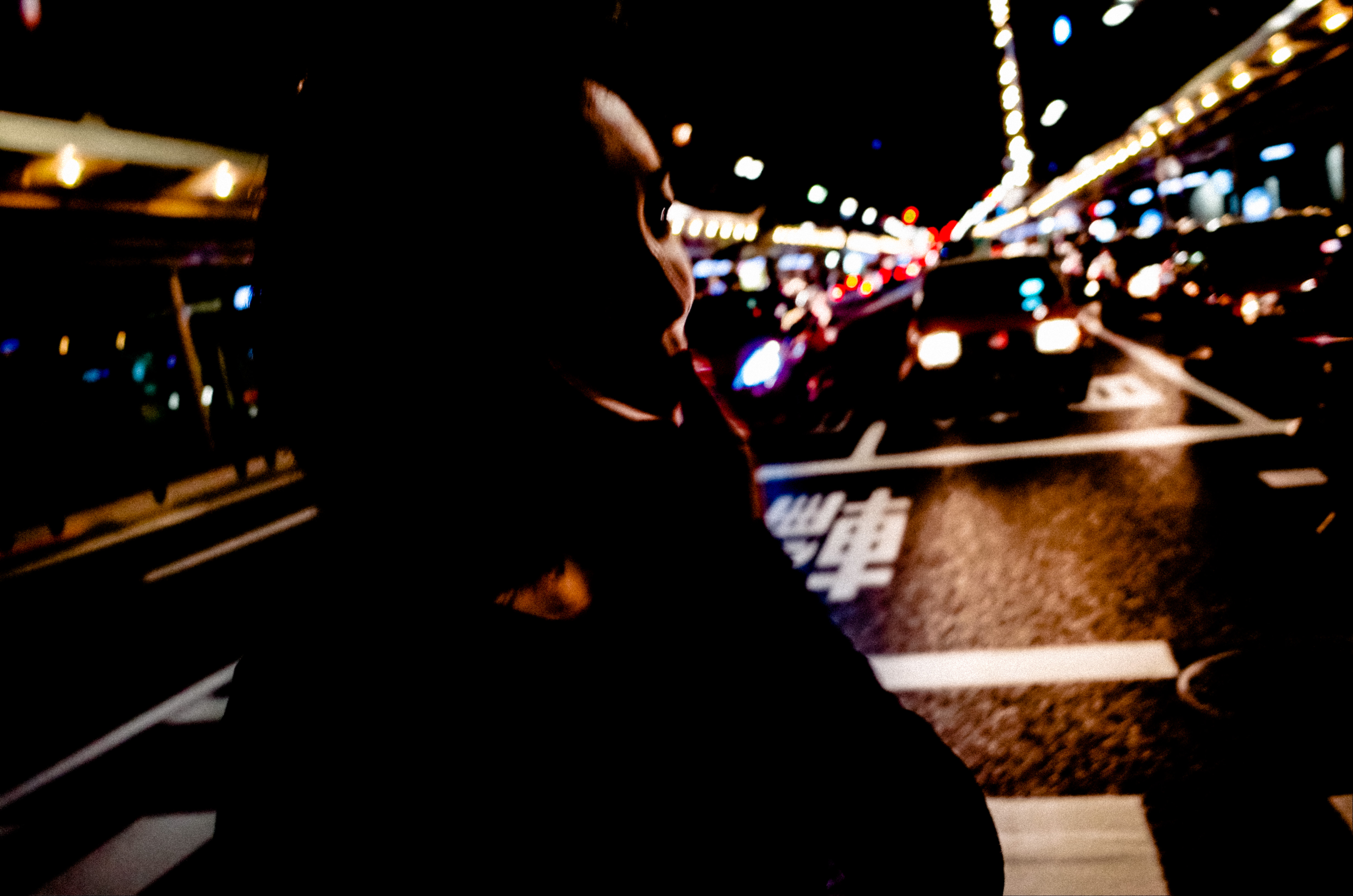 Cindy walking at night, on the streets of Kyoto, 2017