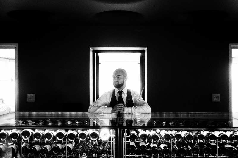 Man standing at bar. Prague, 2015.