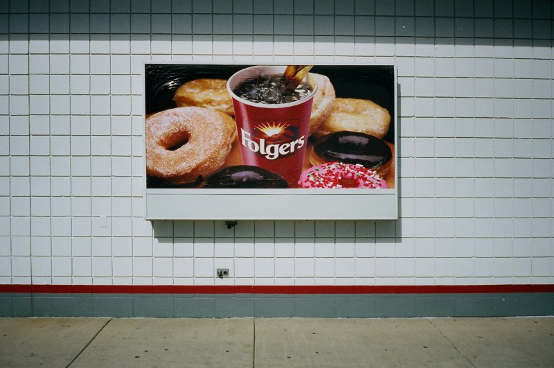Muted red Folgers coffee cup advertisement.