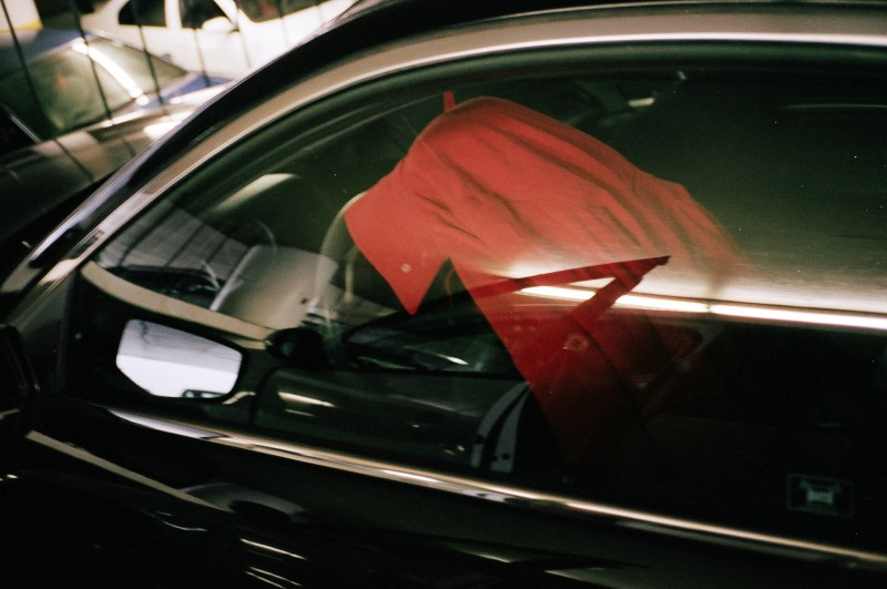 Red coat in car.
