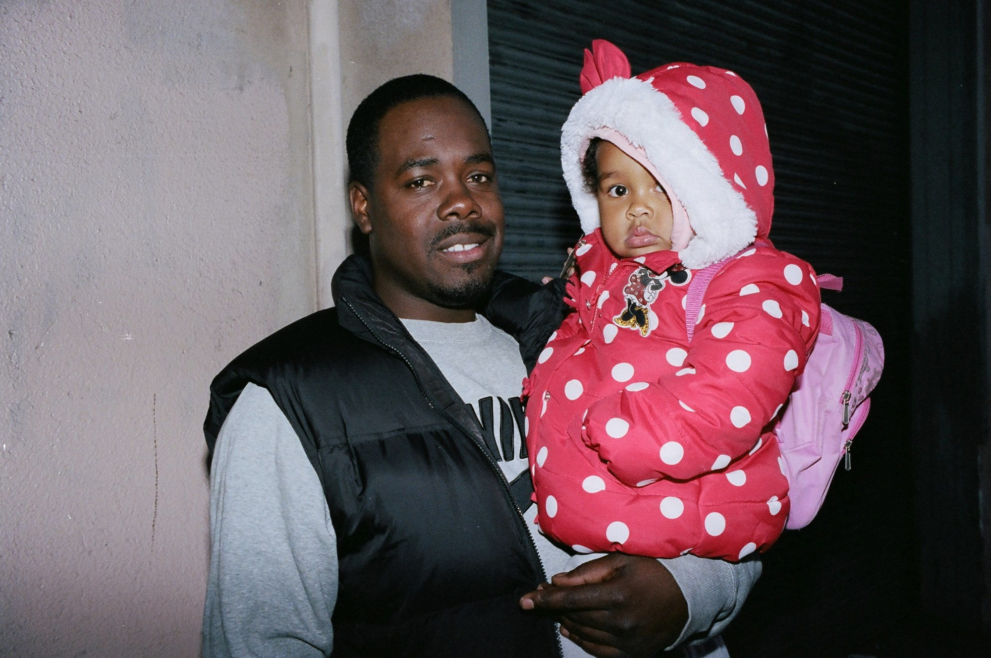 Father and daughter in Minnie Mouse hoodie