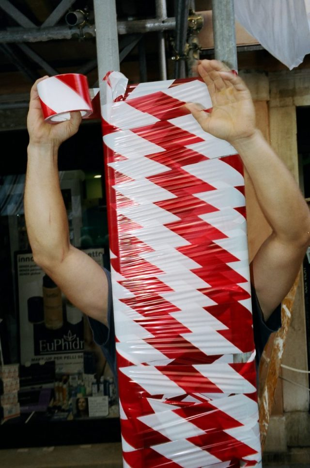 Man with red tape. Venice, 2013