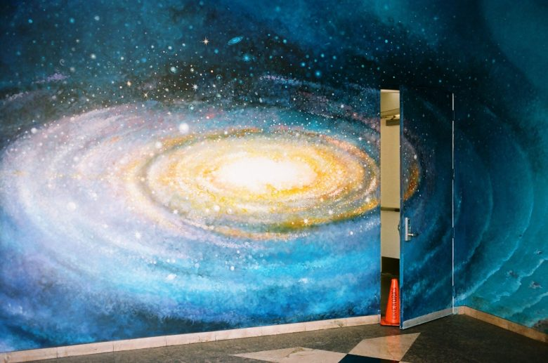 Surreal picture: orange cone behind the universe By ERIC KIM