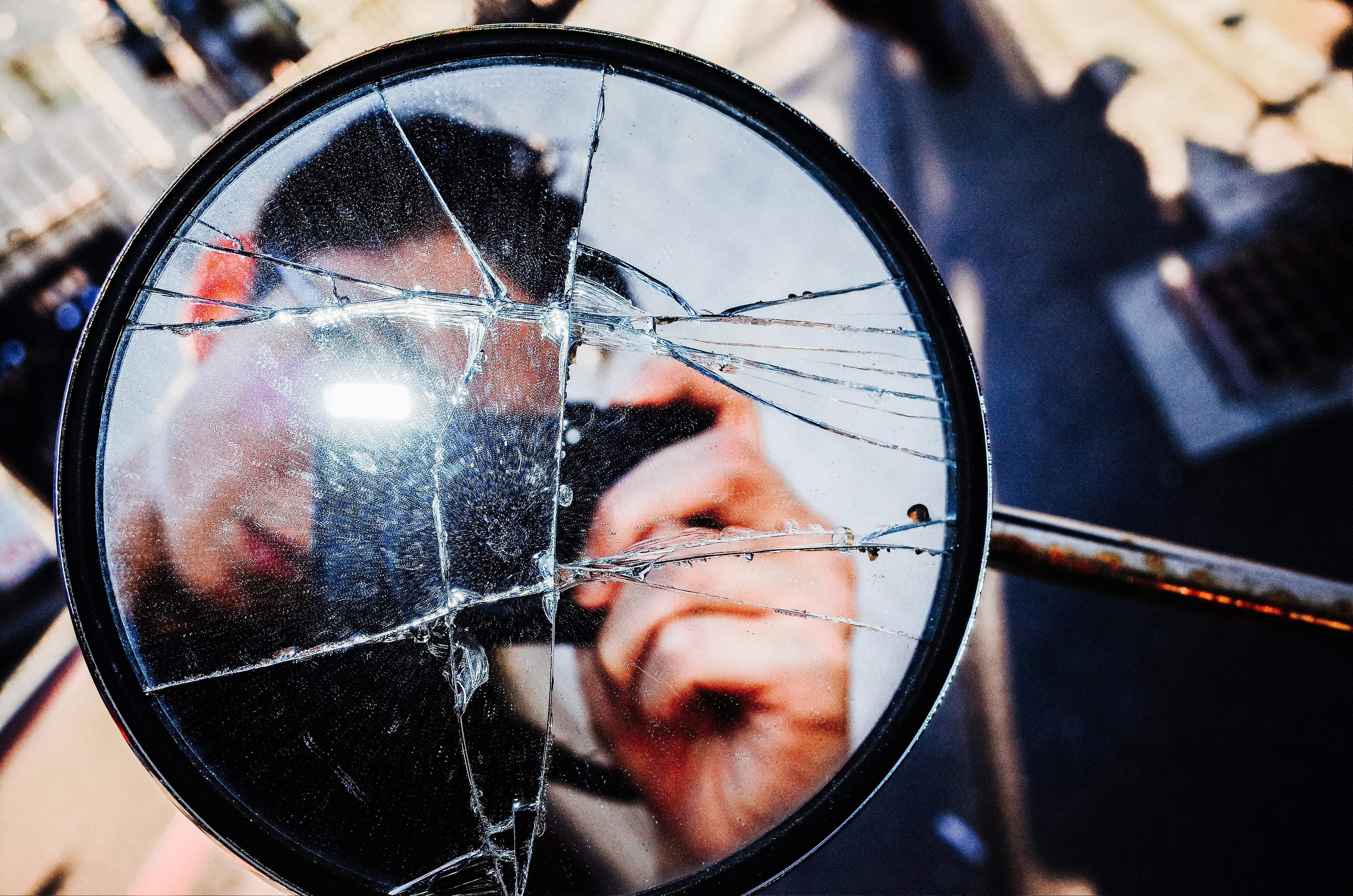 Selfie through broken glass with flash.