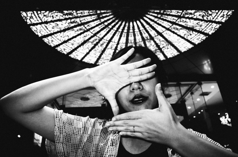 Cindy with hands over her face. Saigon, 2017