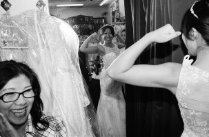 Cindy flexing in wedding dress, 2015