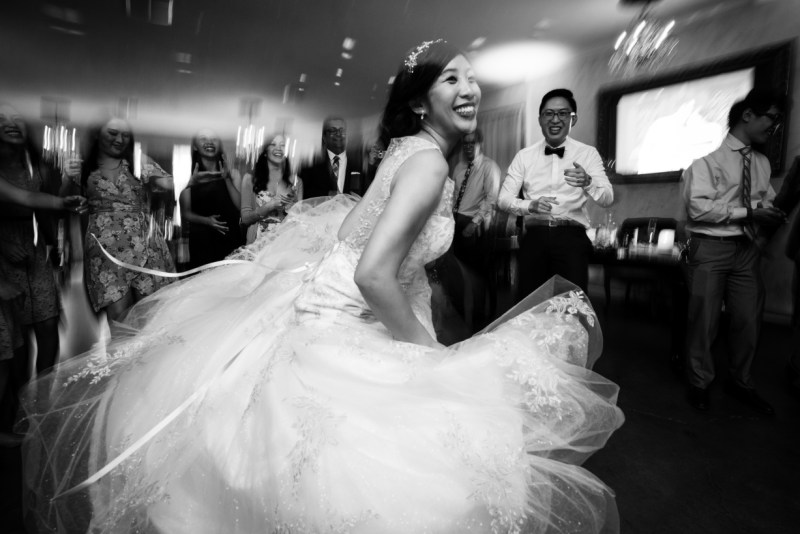 Cindy dancing in wedding dress. Picture by NEIL TA