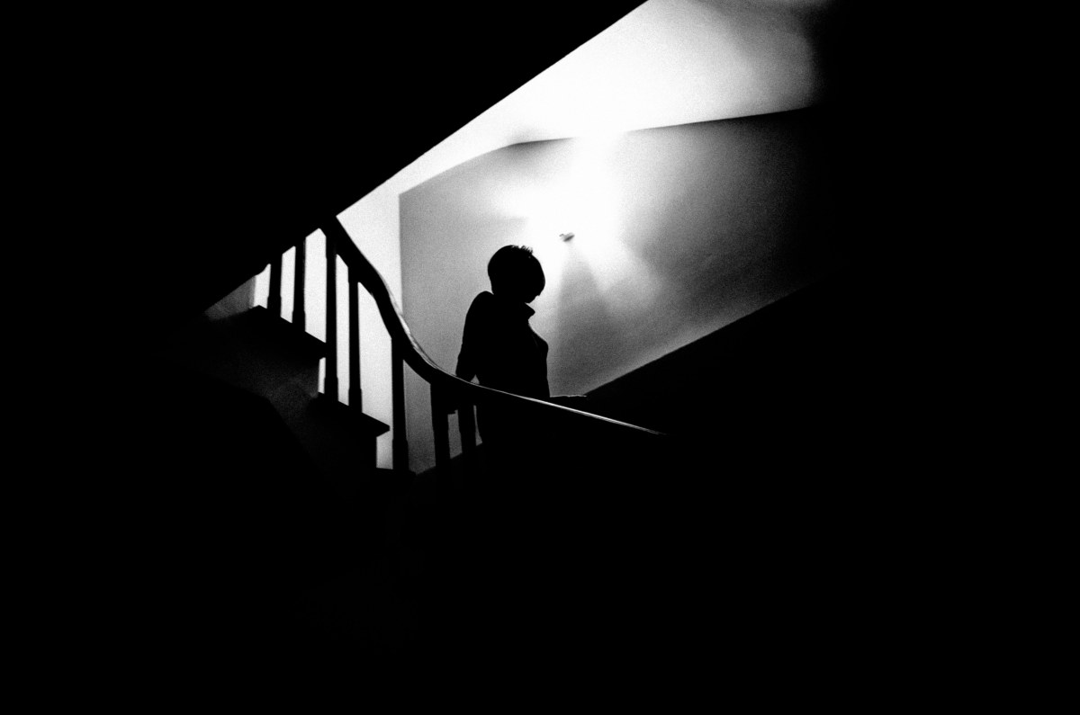 Figure to ground example: Silhouette of Cindy against backlight of stairwell. Hanoi, 2017