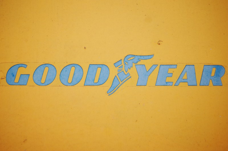 GOODYEAR logo in blue against Yellow Background. Berlin, 2017