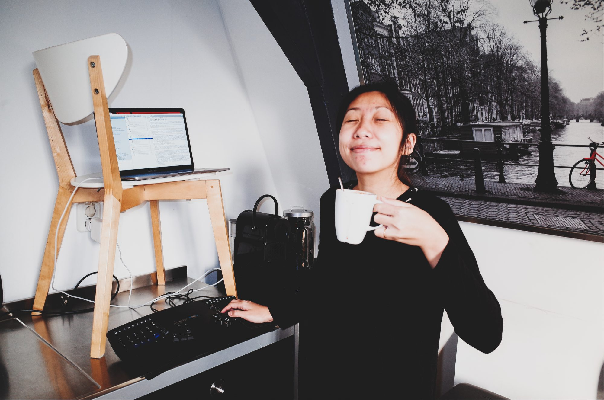Cindy enjoying a nice cup of coffee at our Airbnb in Amsterdam, 2017