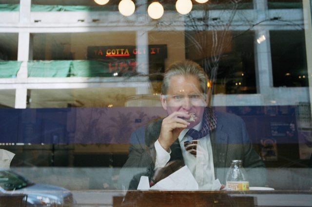 Suit eating sandwich, Chicago. No flash.