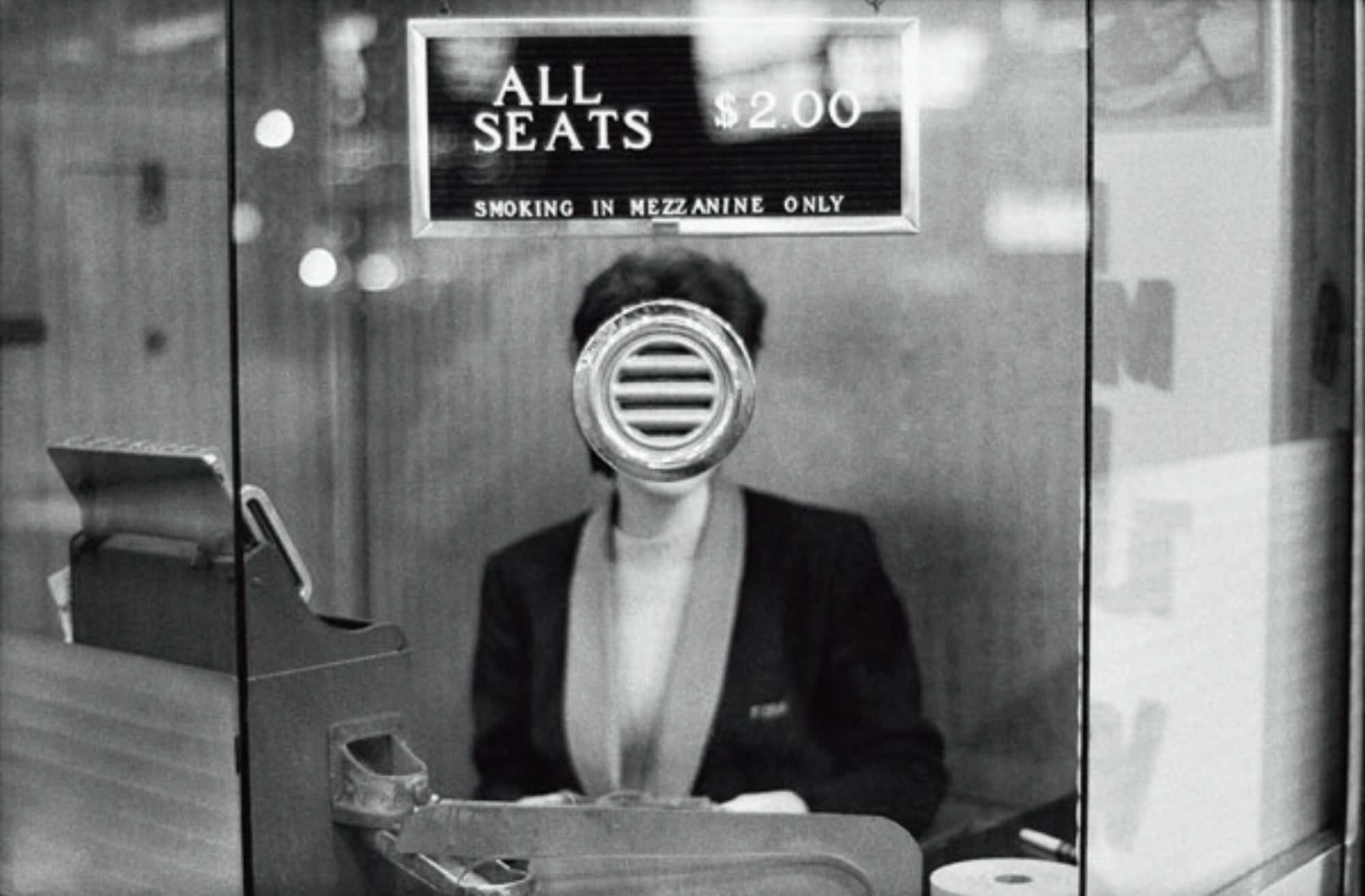 Woman at ticket booth, with head overlapped by Joel Meyerowitz