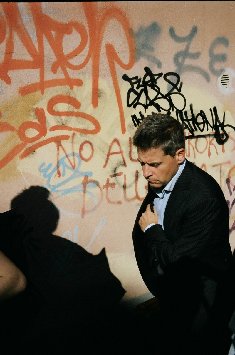 Suit and orange graffiti
