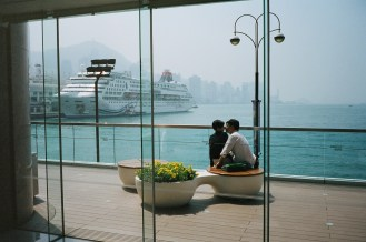 Kissing couple, from inside Hong Kong mall.