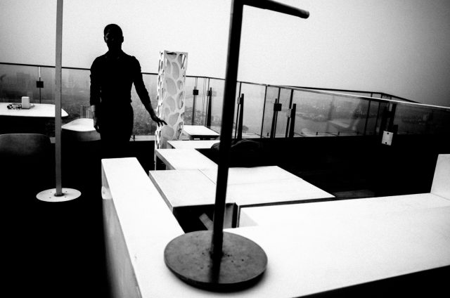 Silhouette of man, rooftop bar in Hanoi.