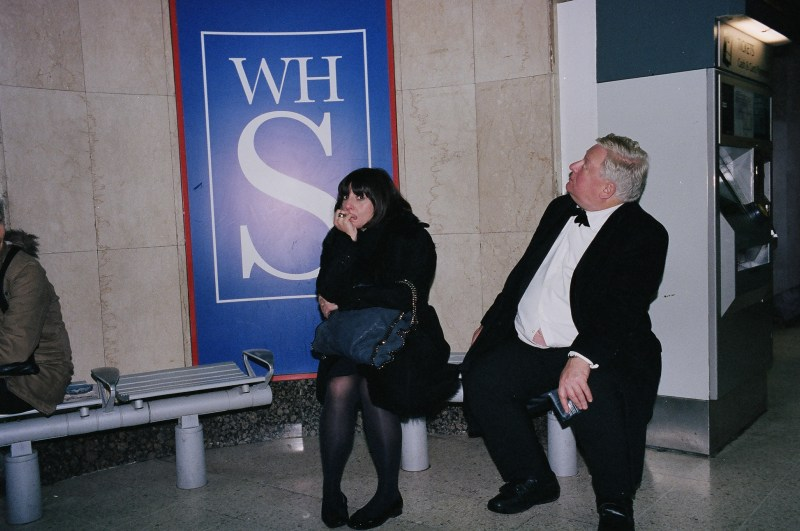 Woman and man in suit. London, 2013