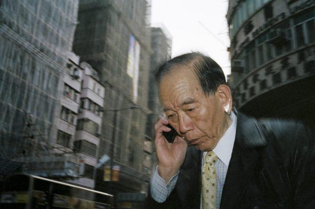 Hong Kong man with phone. 2013