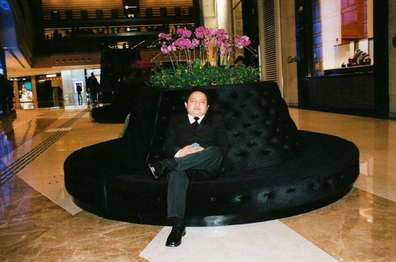 Man taking a nap inside Hong Kong mall.