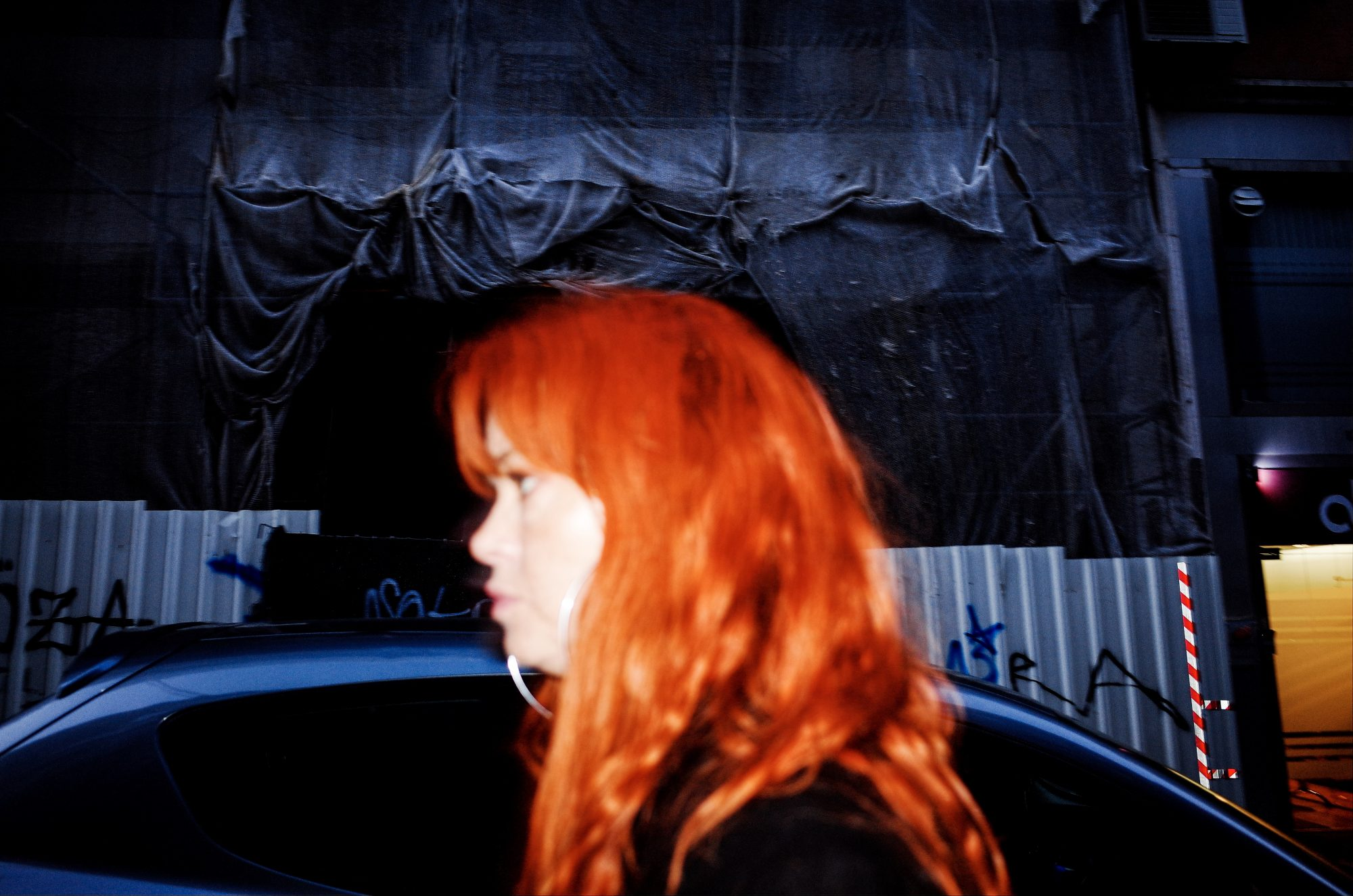 Woman with orange hair. Lisbon, 2018