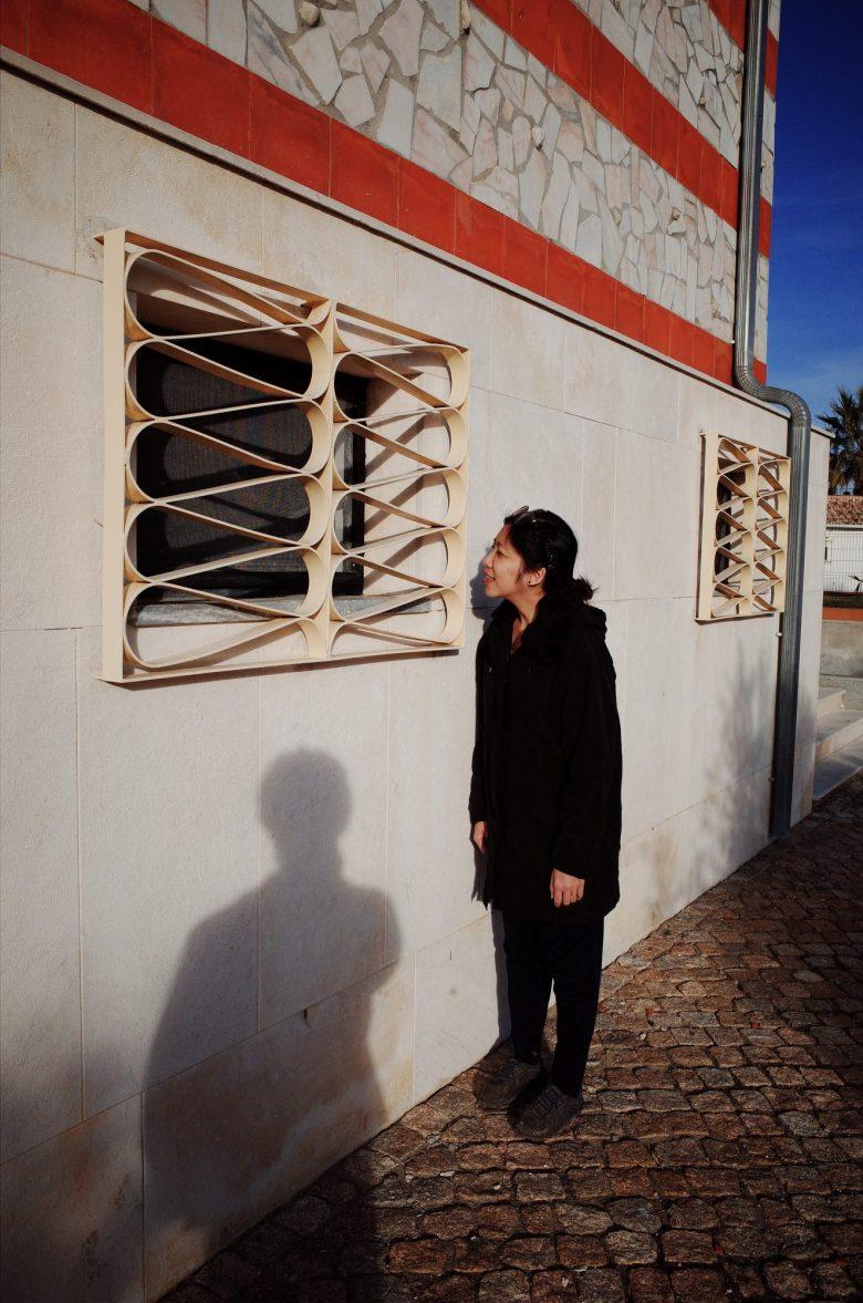 cindy peering into window, lisbon, shadow, selfie