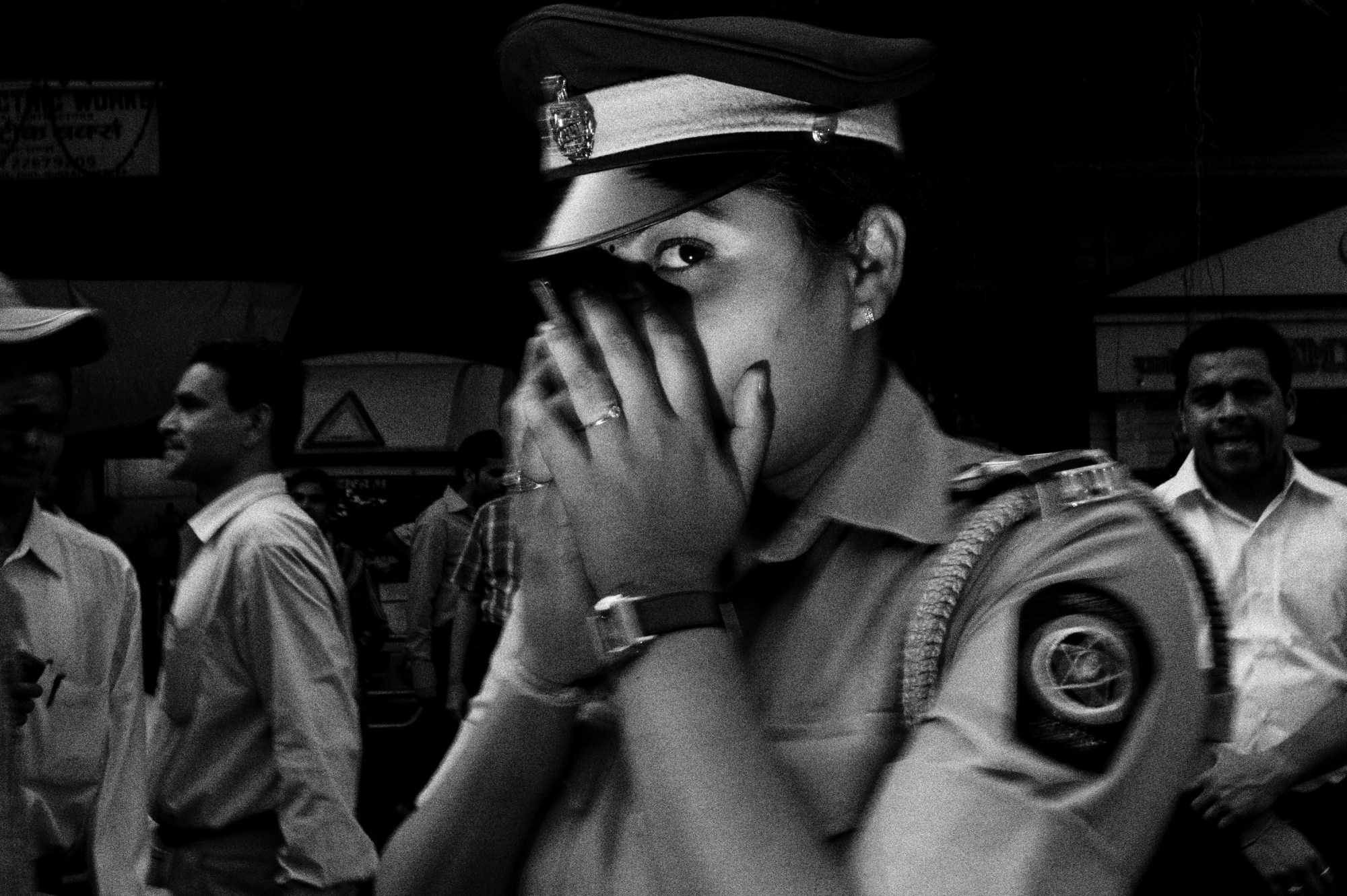 Mumbai woman cop, whisper. Leica M9, flash, 35mm, 1.2 meters.