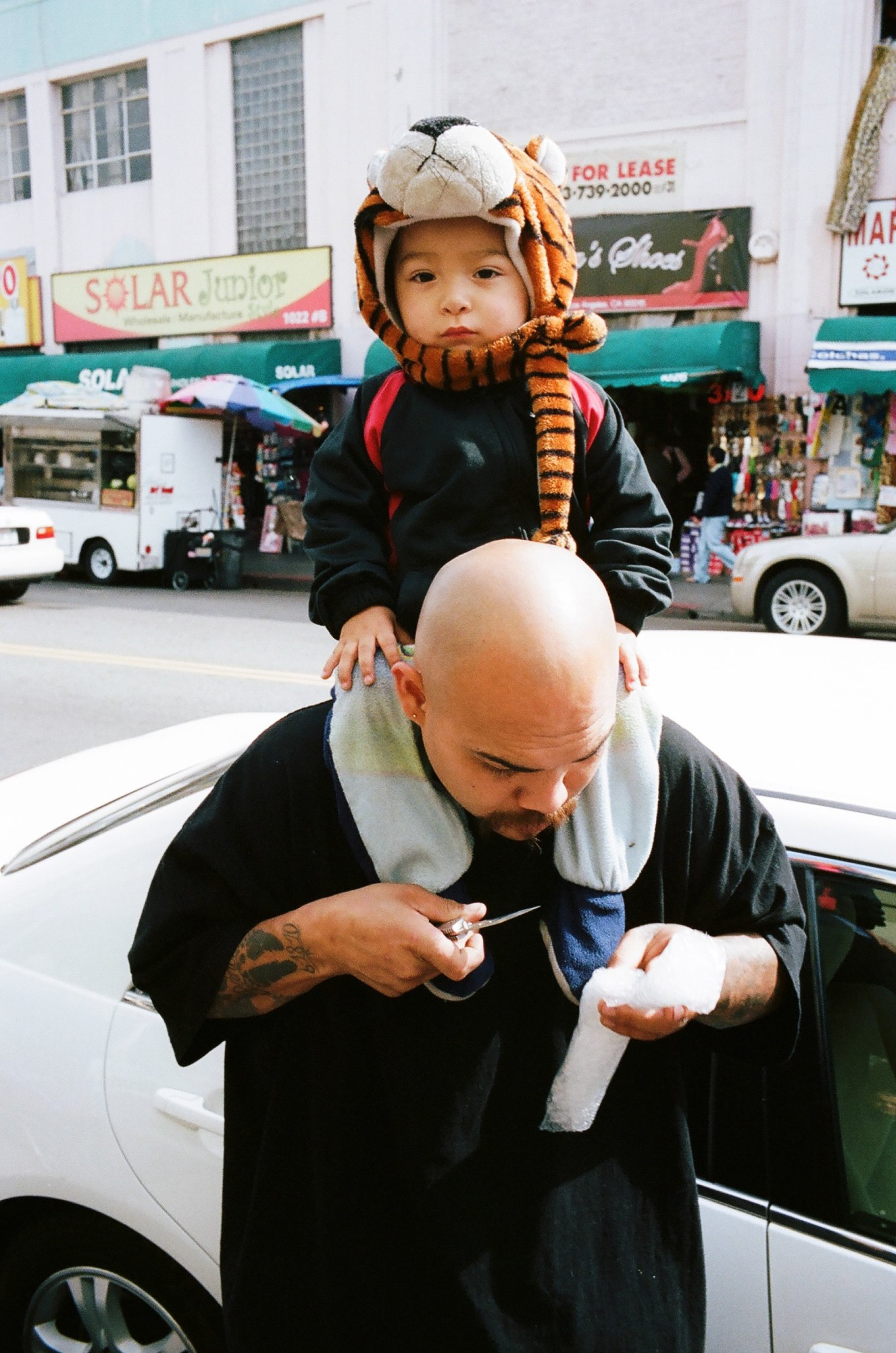 Boy and father. Leica M6, Kodak Portra 400, 35mm, around 1.8 meters.